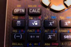 Square root key of the keyboard of a calculator. Machine stock image