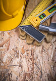 Square ruler construction level hammer yellow hard hat leather g Royalty Free Stock Images