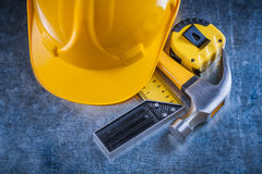 Square ruler measuring tape building helmet and Royalty Free Stock Photo