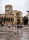 Square of Saint Mary in Valencia Old Town. Valencia, Spain - June 3, 2016: Young man lies on square of Saint Mary with local and tourists in Valencia Old Town in Royalty Free Stock Photography