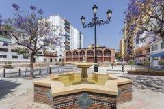 Square in San Pedro de Alcantara, Spain. Market square with fountain in the city of San Pedro de Alcantara. Malaga Province, Andalusia, Spain Stock Photo