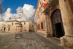 Square in San Quirico d`Orcia. Square with church and city hall in San Quirico d`Orcia, Tuscany Stock Image