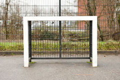 Square schoolyard soccer goalpost front view Stock Photos