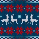 Seamless Pattern Knitted Reindeer And Poinsettia Red White Blue royalty free illustration