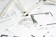 Square set and measurement tool over blueprints Stock Image