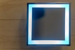Square shape mirror with LED light mounth on white wall in restroom. Square mirror in the bathroom royalty free stock photography