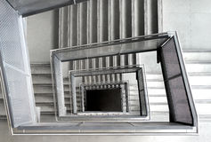 Square shaped stairs in a office building Stock Images