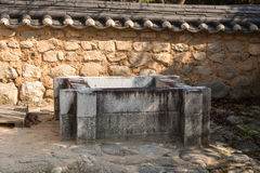 Square shaped stone well Royalty Free Stock Photo
