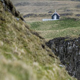 Square Shot of Black Church on Papey Island in Iceland Royalty Free Stock Images