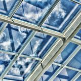 Glass ceiling with window. Square shot, vintage. closeup. The shopping center, business center, royalty free stock image