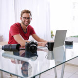 Square shot of a young photographer smiling at camera Royalty Free Stock Photo