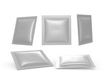 Square silver  foil heat sealed packet with clipping path. Square silver foil heat sealed packet  with clipping path. Packing  or wrapper for sweet, snack, milk Royalty Free Stock Photography