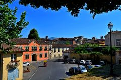 Lucca city Italy. Square sky windows cloud tower colors country road street courts green door panorama sunset courts sleep square Italy Stock Images