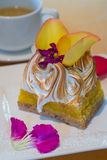 Square slice of fancy lemon meringue dessert garnished with  yel Royalty Free Stock Images