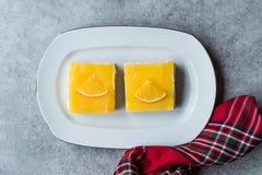Square Slice of Orange Mascarpone Quark Cake. Dessert Concept stock photo