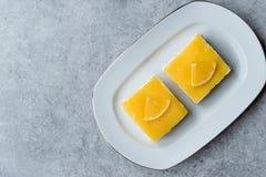 Square Slice of Orange Mascarpone Quark Cake. Dessert Concept stock image
