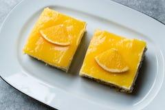 Square Slice of Orange Mascarpone Quark Cake. Dessert Concept royalty free stock image