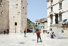 A Square in Split. SPLIT, CROATIA - MAY 19, 2013: Pedestrians in the historic center of Dalmatian city of Split, Croatia On May 19, 2013, in Split, Croatia Royalty Free Stock Photos