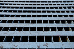 A square steel manhole cover Stock Photography