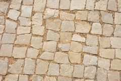 Stone cobbles background. Square stone pavement cobbles, Albufeira, Portugal, Europe stock image