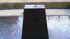 Square stone shaped water fountain stock footage