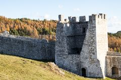 The square stone tower of a medieval castle. On the background of blue sky Royalty Free Stock Image