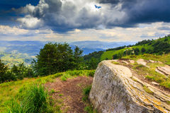 Square stone waiting the storm on top of the mountain. Big white square stone on top of the mountain before the summer storm Royalty Free Stock Images