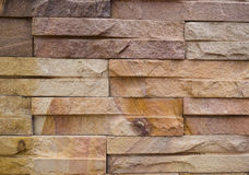Square stone wall. The brown square stone that make up the beautiful wall Stock Photos
