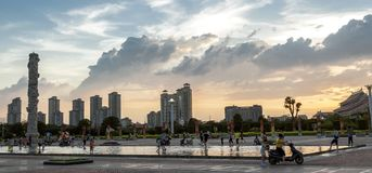 Square in the sunset. People enjoy in the square of Fujian-Taiwan kinship Museum in the evening sunset, Quanzhou city, Fujian province, China Royalty Free Stock Images