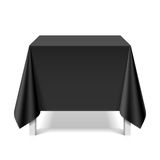 Square table covered with black tablecloth Royalty Free Stock Images