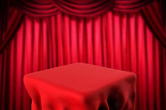 Square table and red curtain background Stock Images