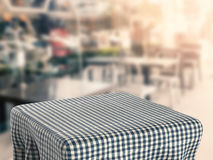 Square table with tablecloth Stock Photo