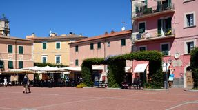 Square and tables in Porto Azzurro, in Elba island, Italy Stock Photography