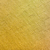 Square textile background - yellow painted fabric Royalty Free Stock Photo