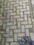 Gray path for pedestrians as background stock photos