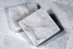 Square Tiles of White Carrara Marble Stock Image