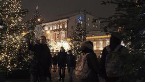 Square with trees decorated with garland lights at night city winter street. Square with trees decorated with garland lights at christmas dark night city winter stock video footage