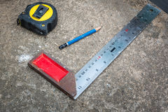 Square triangle scale , Pencil and Measuring Tape Royalty Free Stock Images