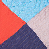 Square from triangles in stitched patchwork quilt. Close up Royalty Free Stock Images