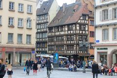 Square with typical architecture of Alsace region in Strasbourg at the Ill river Stock Photography