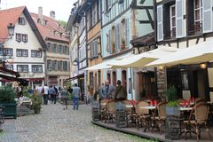 Square with typical architecture of Alsace region in Strasbourg at the Ill river Stock Image