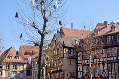 A square with typical half-timbered houses in the Alsace region. Square with the typical and traditional half-timbered houses of the Alsace region of France royalty free stock photos