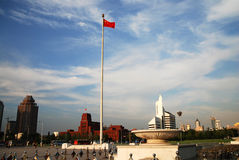 Square under blue sky. The Square with Chinese National flag under blue sky in the People square, Dalian, China Stock Image