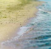 Square vibrant cross process sand beach with tidal waves Royalty Free Stock Photos