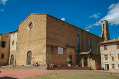 Square view of the church of Sant`Agostino with people in San Gimignano. Royalty Free Stock Photo