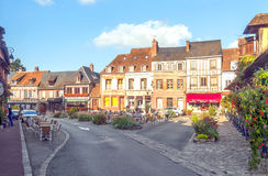 Square of a village. In northern France on a sunny day people walking and cafeterias looks. It is an editorial image taken in October 2015 Royalty Free Stock Photos