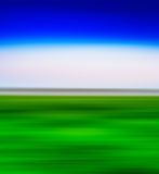 Square vivid green landscape with blue sky abstraction Stock Image
