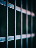 Square vivid prison cell bars. Closeup deatil bokeh background backdrop Stock Photo