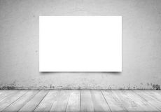 Square white canvas hanging on concrete wall in interior Stock Photography