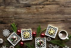 Square White Christmas Theme on Brown Wooden Floor royalty free stock photo